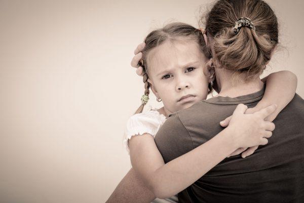 sad daughter hugging mother