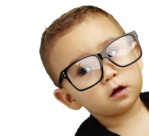 Small boy wearing big glasses
