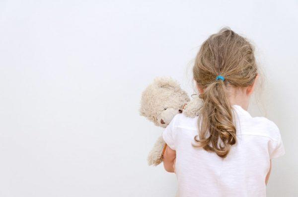 sad child with a teddy bear